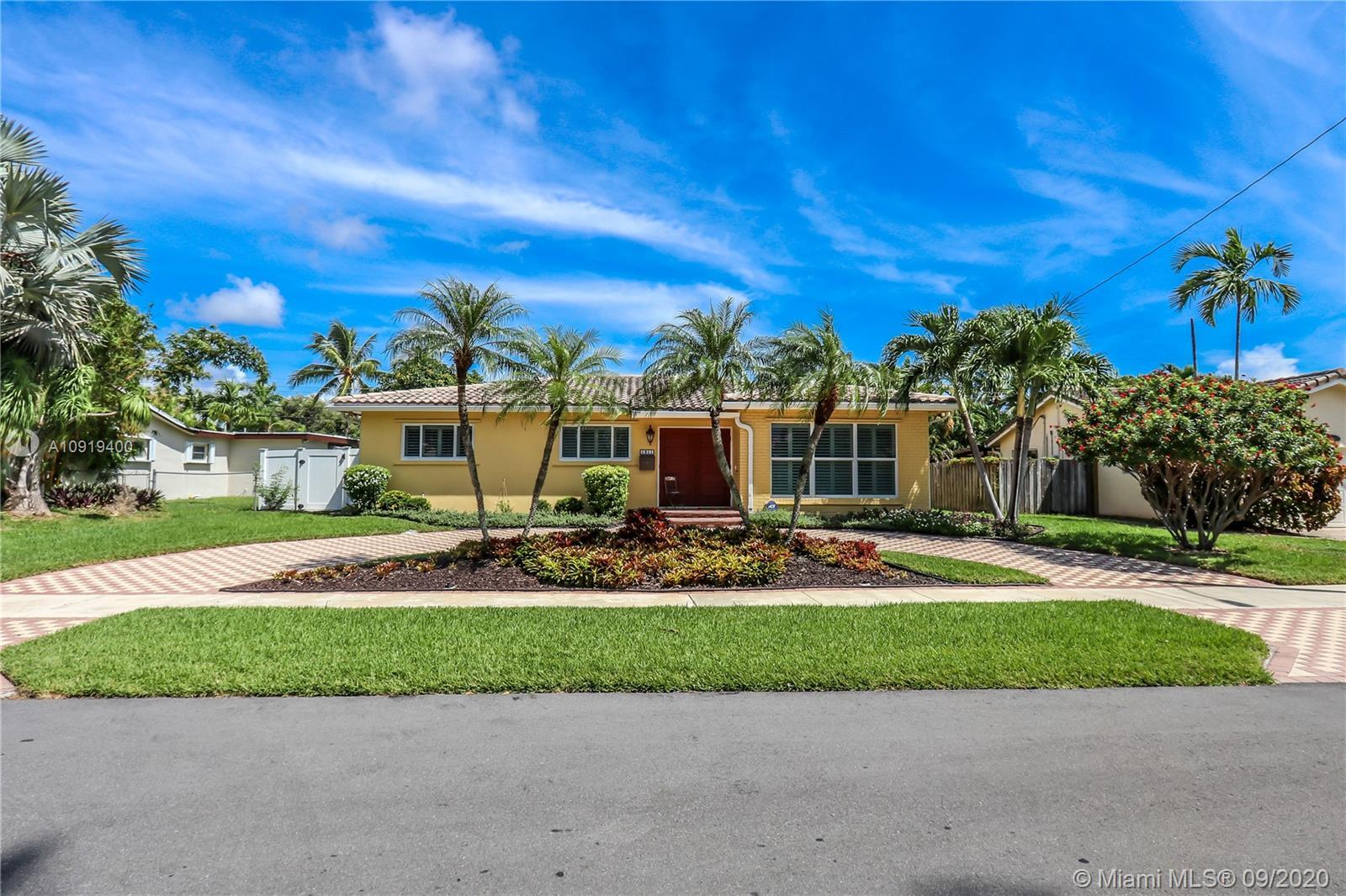 Gorgeous 3 bed/2.5 bath pool home with beautiful curb appeal and tropical landscaping nestled in His