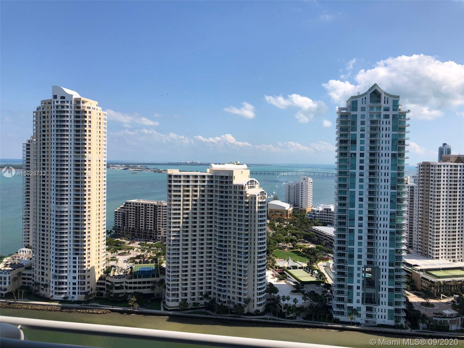 Spectacular 180 degree views of Miami River, Key Biscayne and Downtown Miami. This Split 2/2 floor p