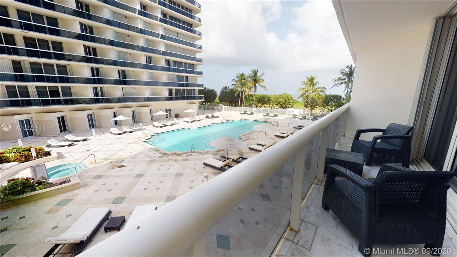 This spacious 2 bedroom 2 1/2 bath unit with 10 ft ceilings at Solimar Condominium in Surfside is th