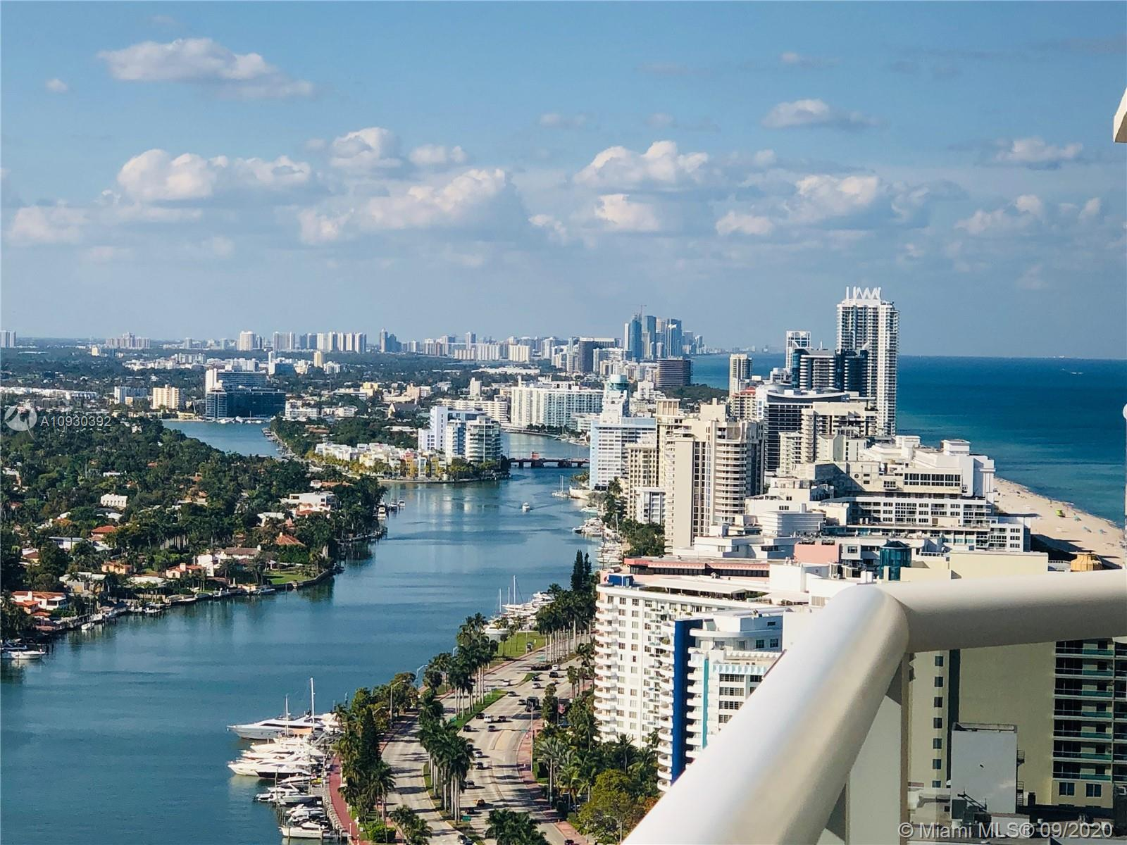 This high floor unit has spectacular unobstructed views of the bay and Miami's skyline, with floor t