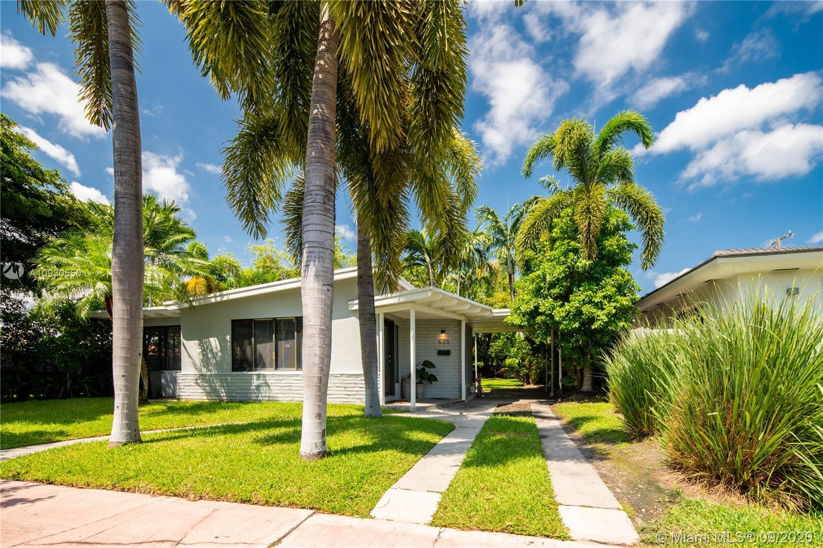CHARMING MID CENTURY MODERN HOME LOCATED IN THE PRESTIGIOUS NORMANDY SHORES GOLF COMMUNITY. THE HOME