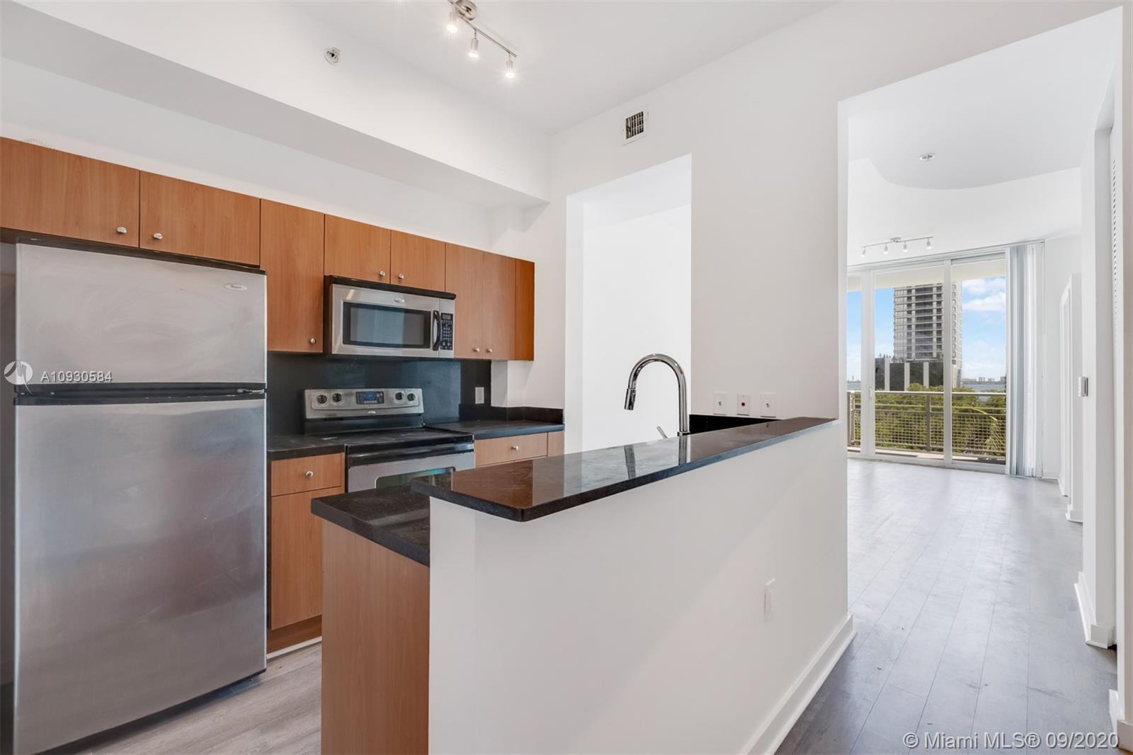 Just redone and never lived in! Bright and spacious  1-bedroom condo with balcony and partial bay vi