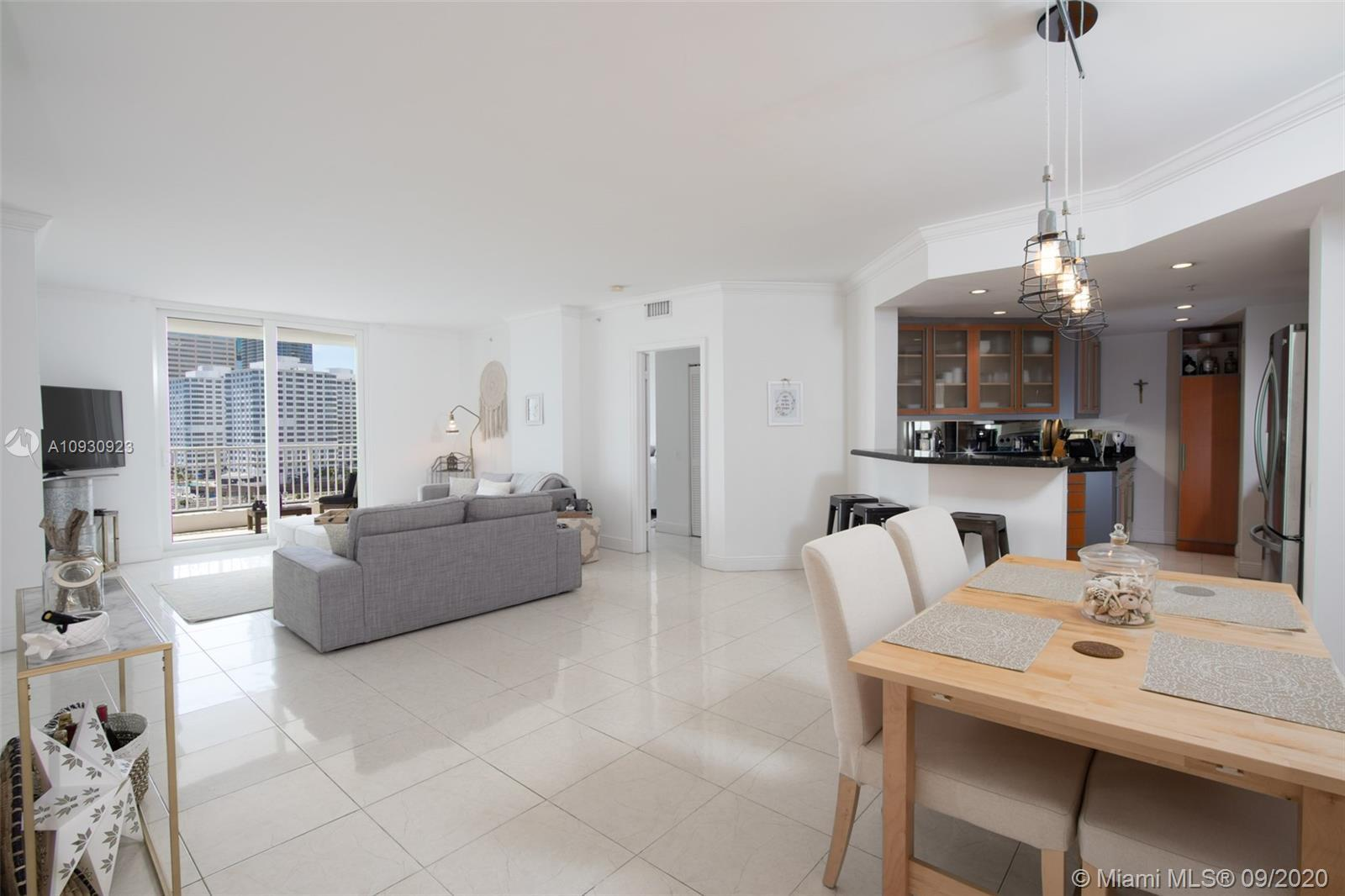 AMAZING, DIRECT BAY VIEWS FROM THIS UPDATED & BEAUTIFULLY DECORATED 2 BEDROOM 2.5 BATH WITH IMPACT W