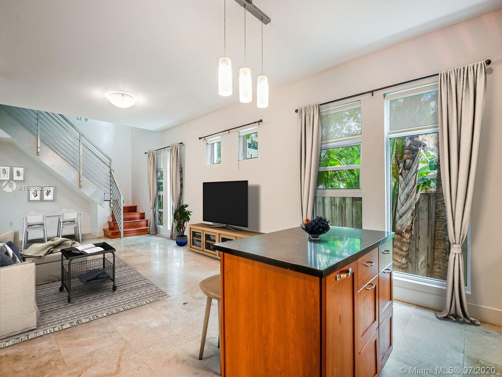 This spacious 2 Bed/2.5 Bath Lunamar Loft is one of just eight townhomes located in one of South Bea