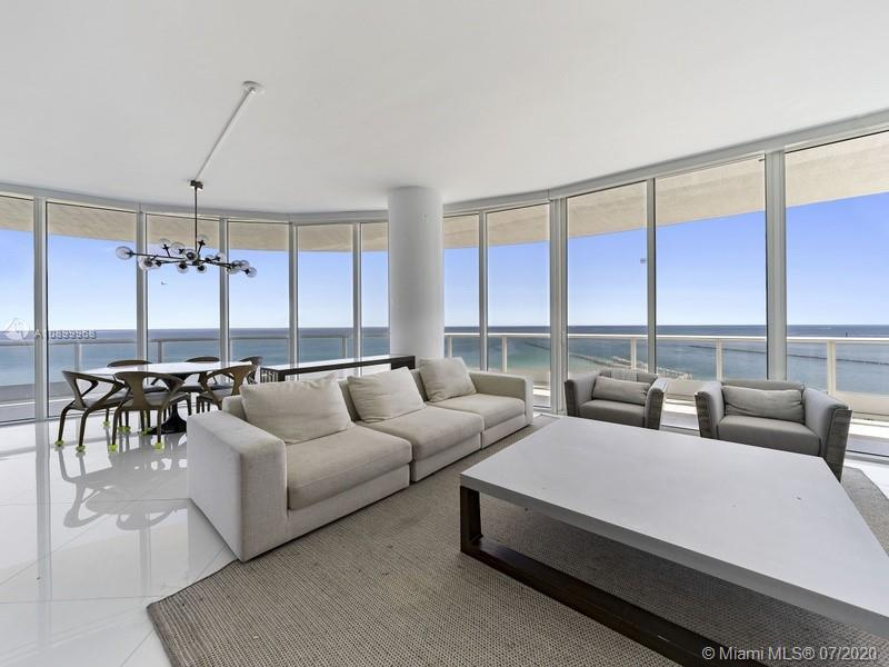 Direct ocean views from the large, wrap around balcony of this updated three bedroom home.  The kitc