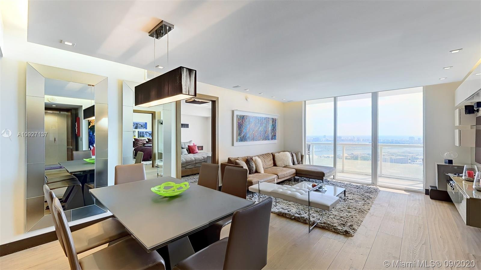 This stunningly upgraded residence features direct unobstructed views of Biscayne Bay and Miami Beac