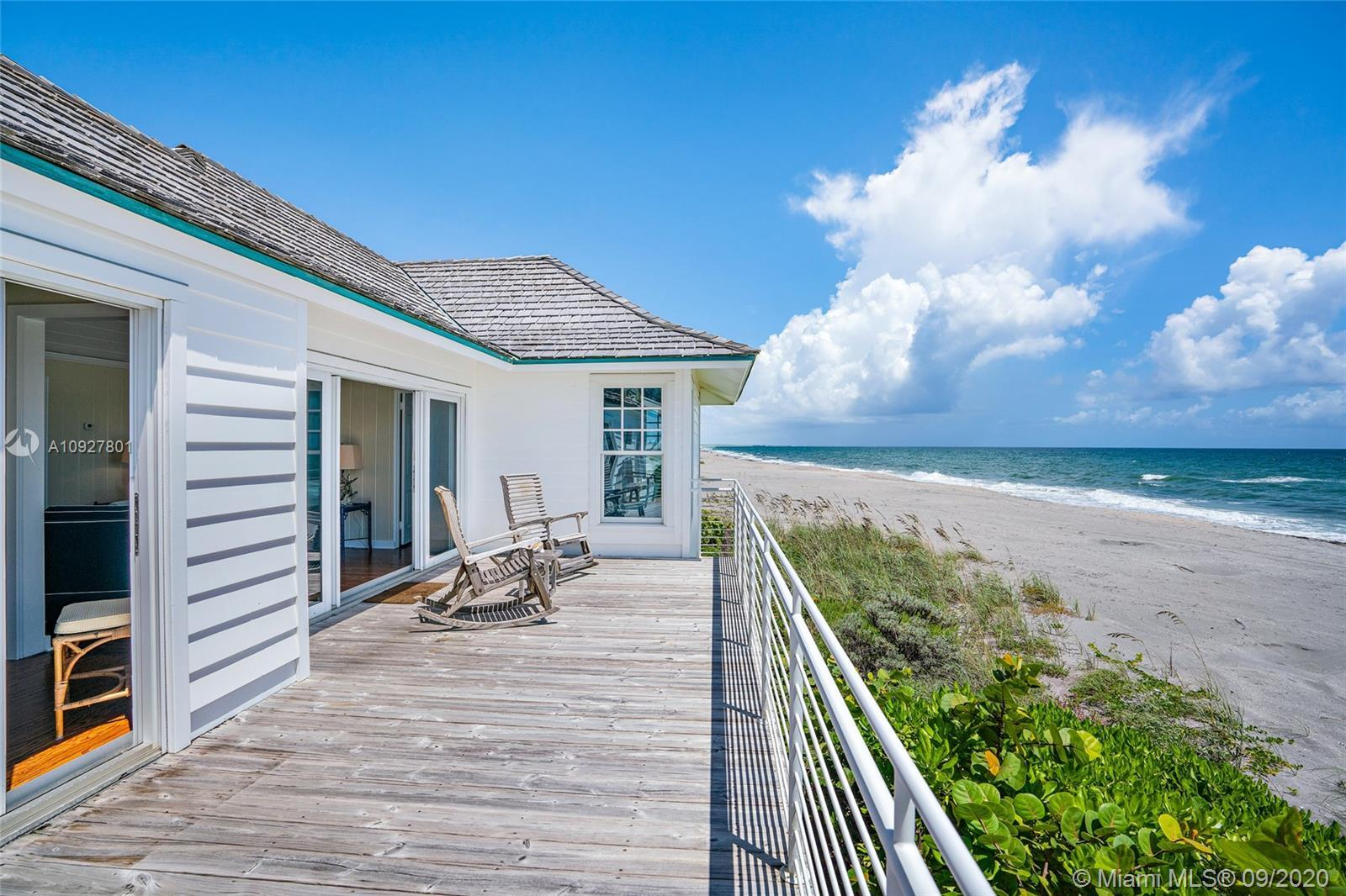 This charming, private Jupiter Island beach cottage is directly on the sand and has wide expansive o