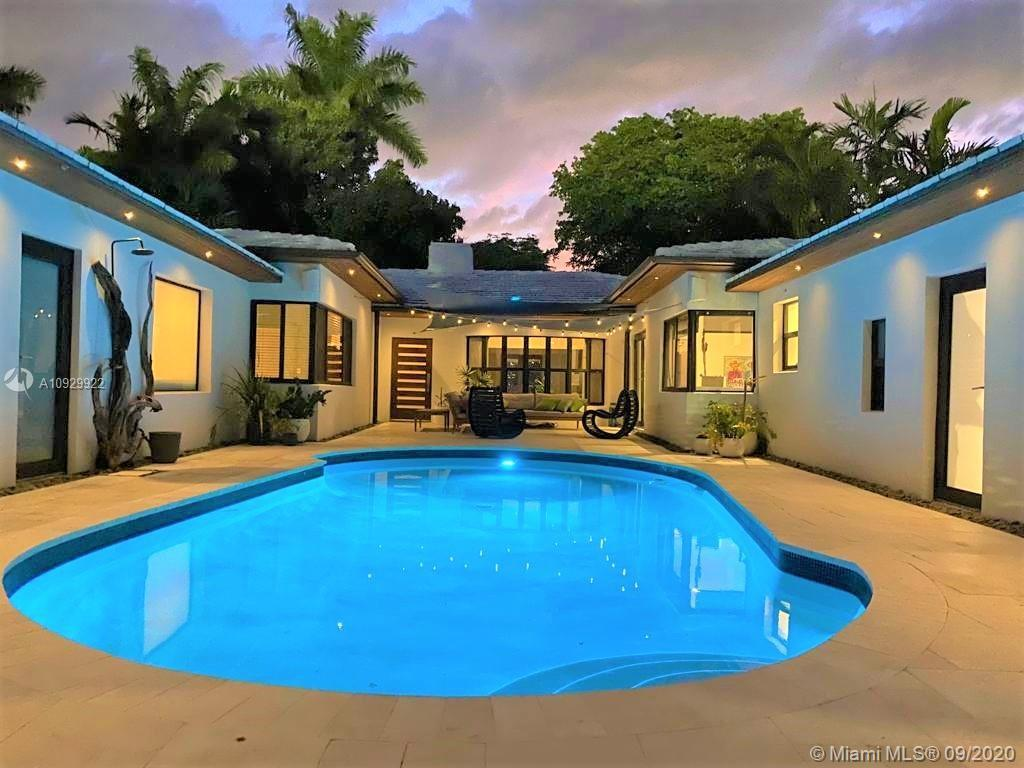 Miami Beach Chic... 3 Bed/2 Bath + 1/1 In-Law Suite has Bright Spacious Floorplan with rooms that fl