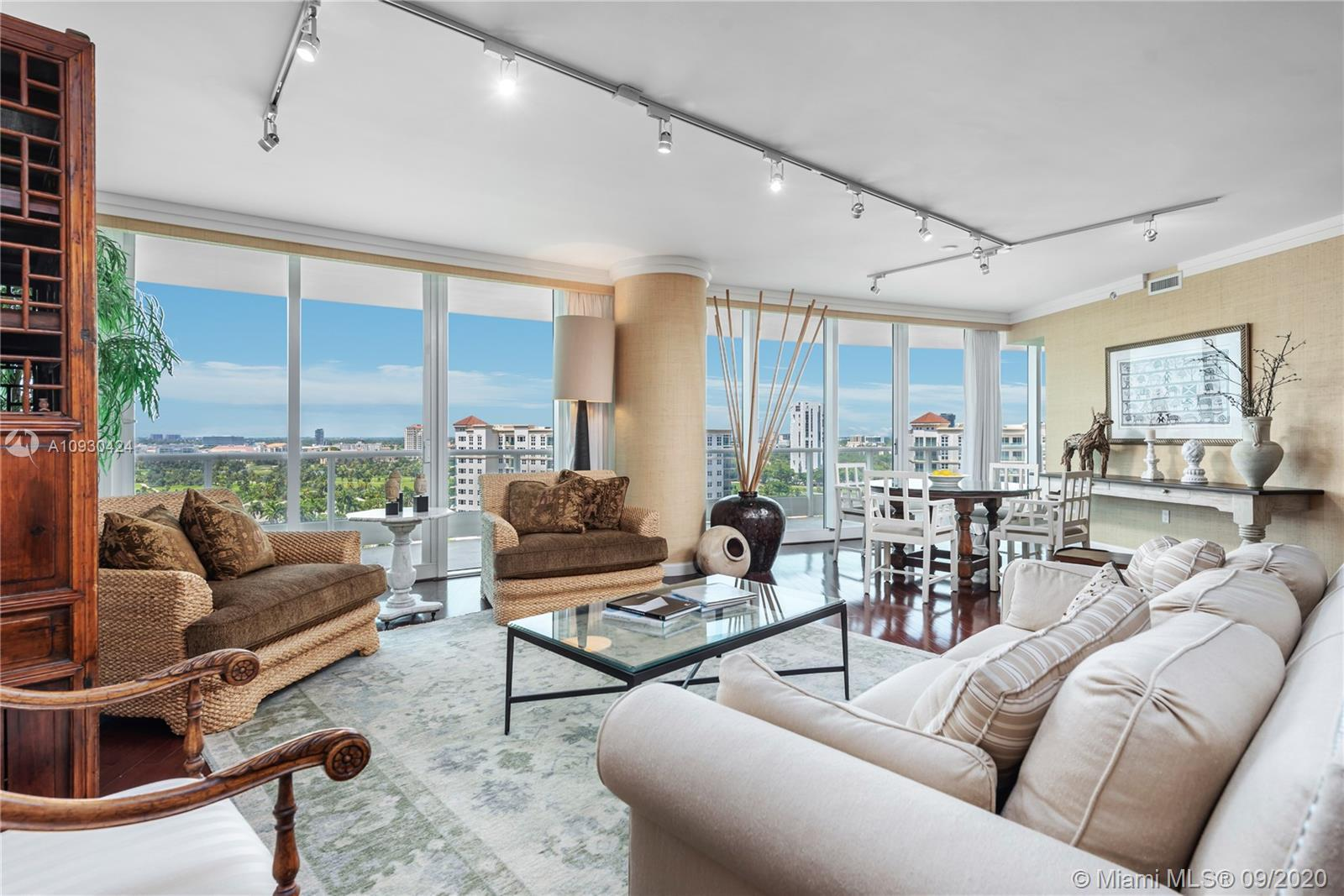 Beautifully designed furnished 2 bedroom, 3 1/2 bath + den has a split floor plan and priced to sell