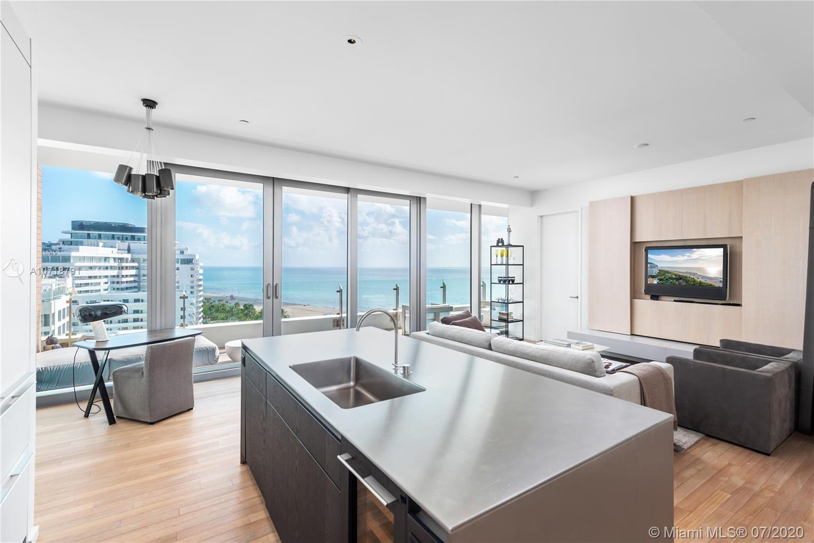 Spacious 1 bedroom 1 and a half bath featuring full-length windows and terrace with ocean and Indian