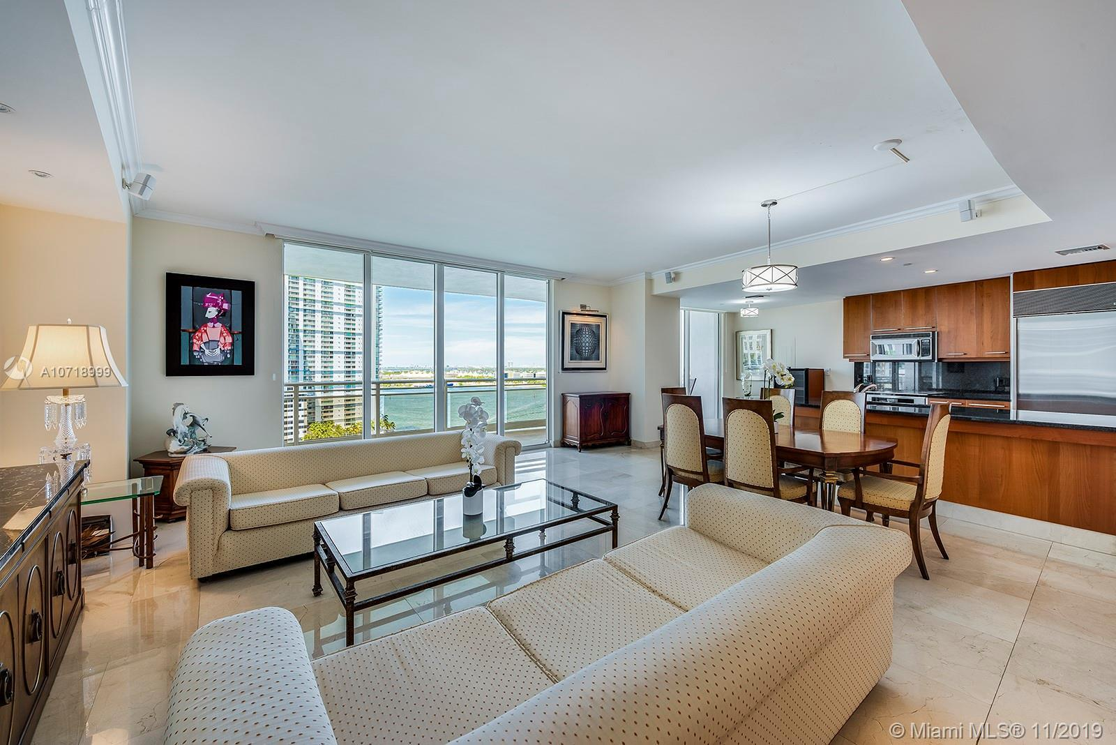 Spacious 2 bed 2.5 bath with breathtaking views overlooking the beautiful open bay waters.  Marble p