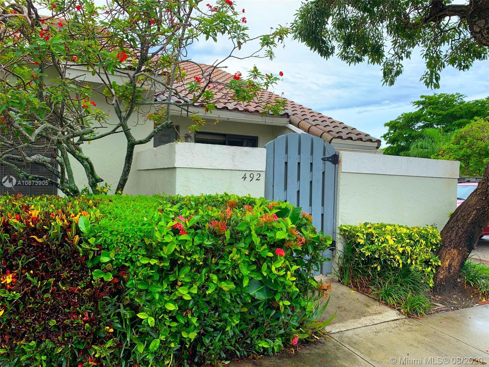 Bright corner townhouse with vaulted ceilings in the desirable community of Windwood-Boca Raton. The