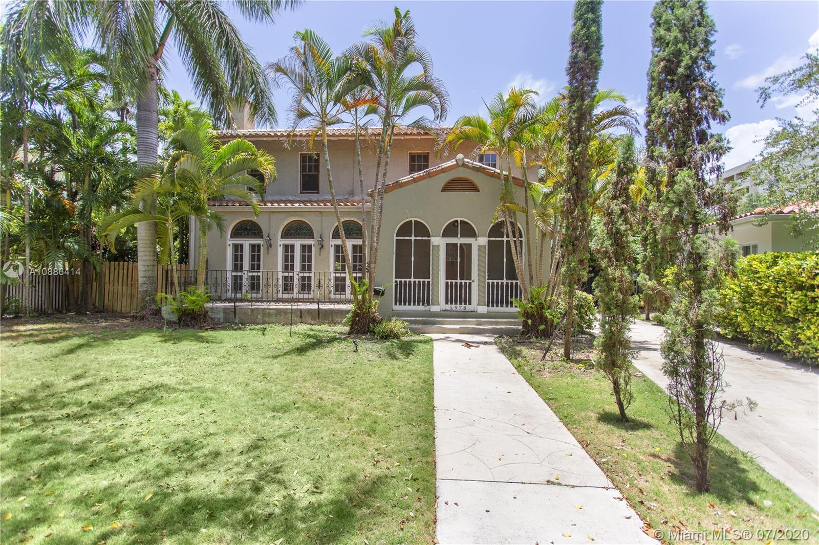 Historical Home in a gated community Two Story home  and a guest house.  Pool area is complete with