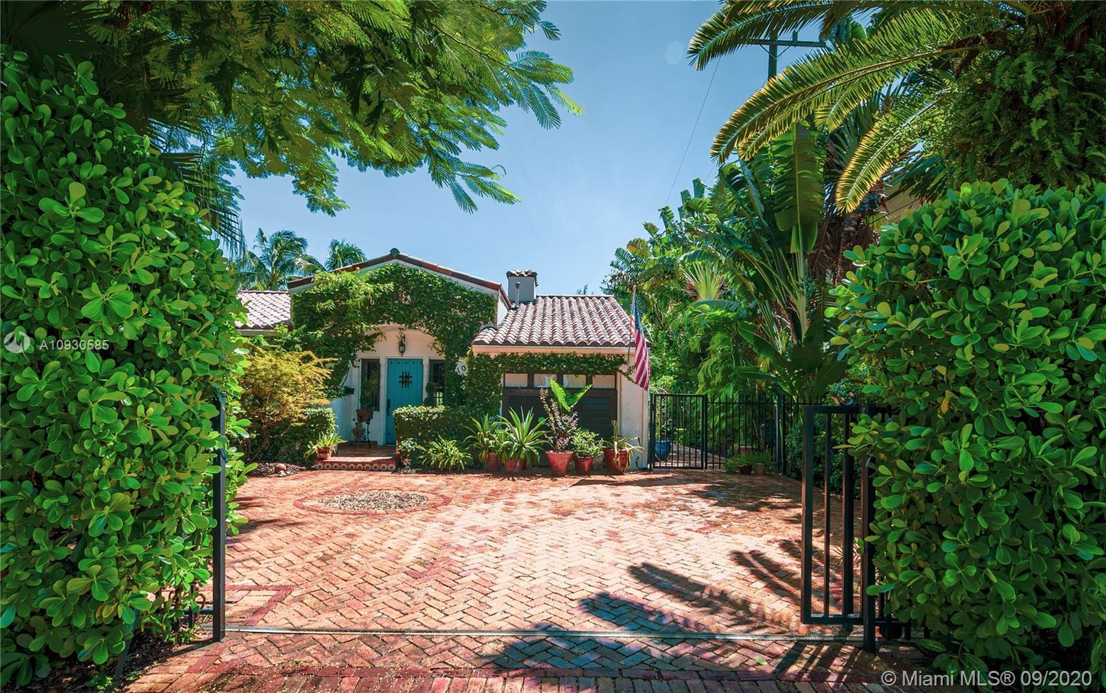 A gated driveway and plant walls seclude this 8,000 sqft parcel of land from the bustling neighborho