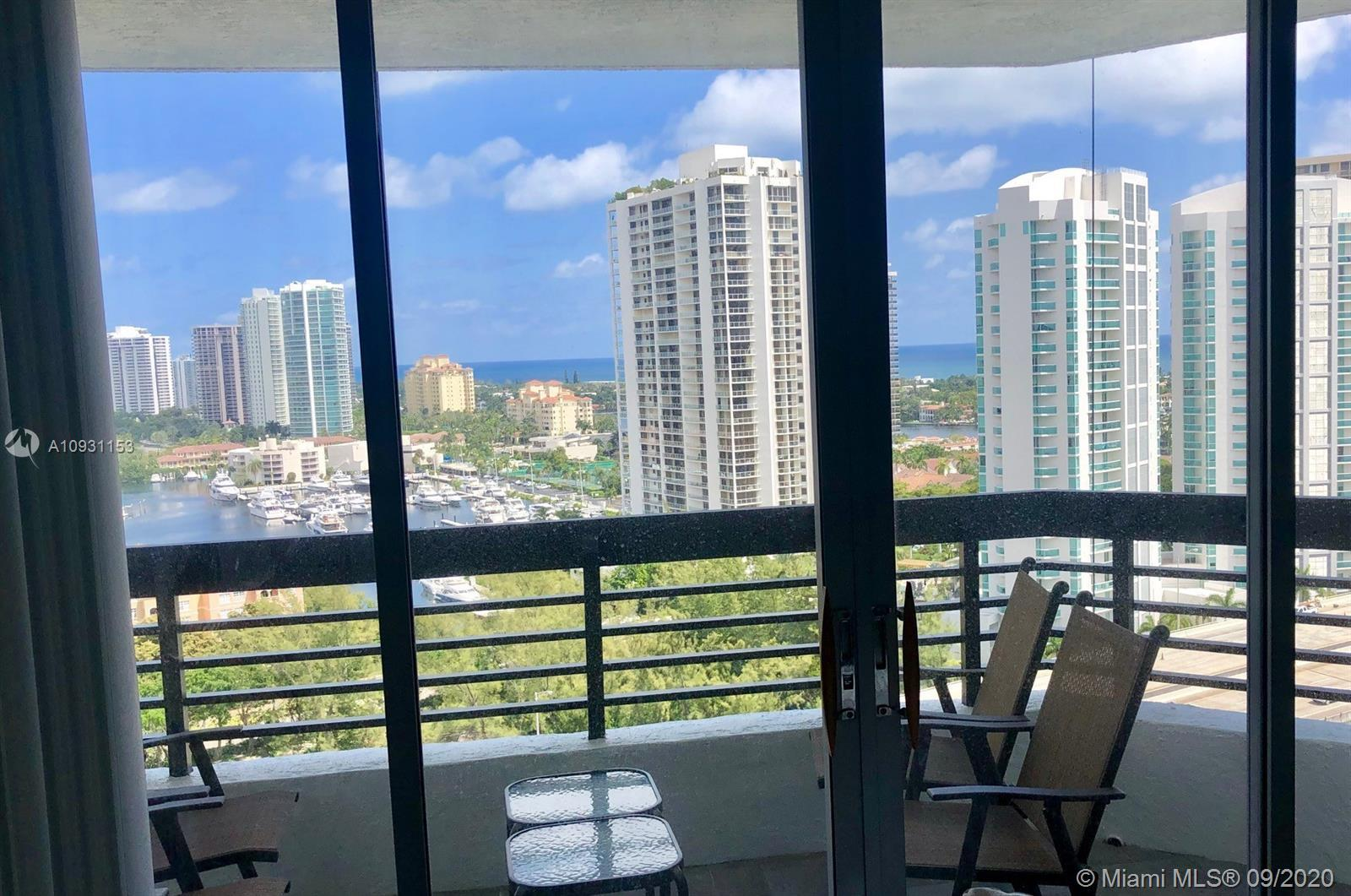 Beautiful Corner Unit, 2 Bed, 2 Bath + Den. Stunning Golf & Water Views from Every Room. Marble Floo