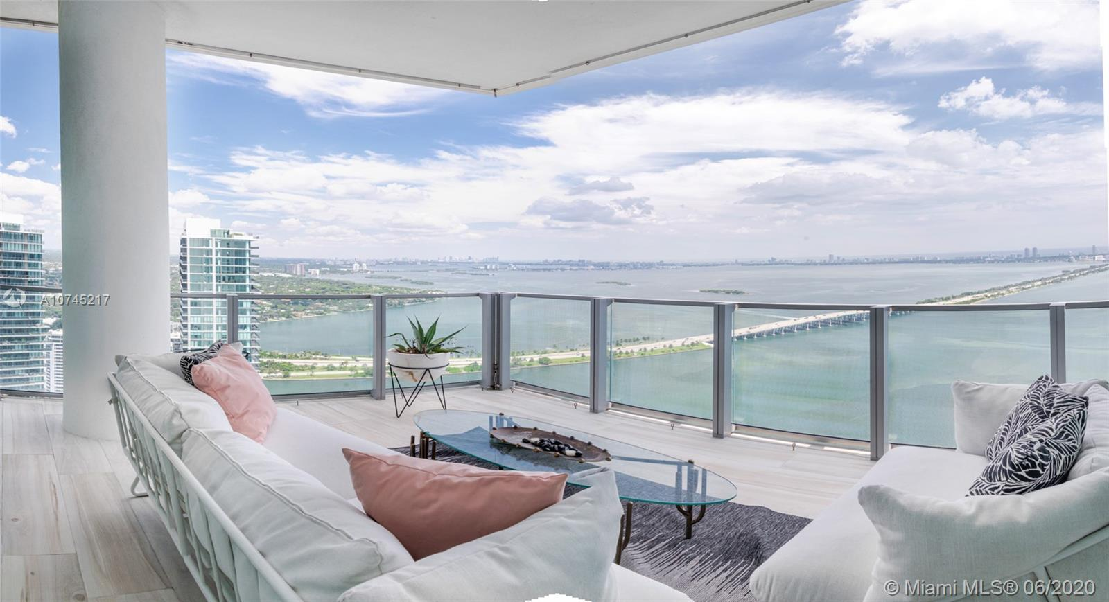 Spectacular NE corner Penthouse 3BD/3.5BA plus oversized family room with direct bay and ocean views