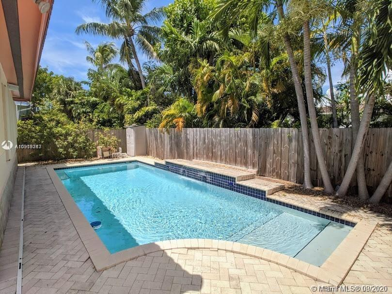Spacious 3 bedroom 3 bathroom 2403 sq ft SURFSIDE home WITH IN GROUND 14'X30' POOL with pool deck an