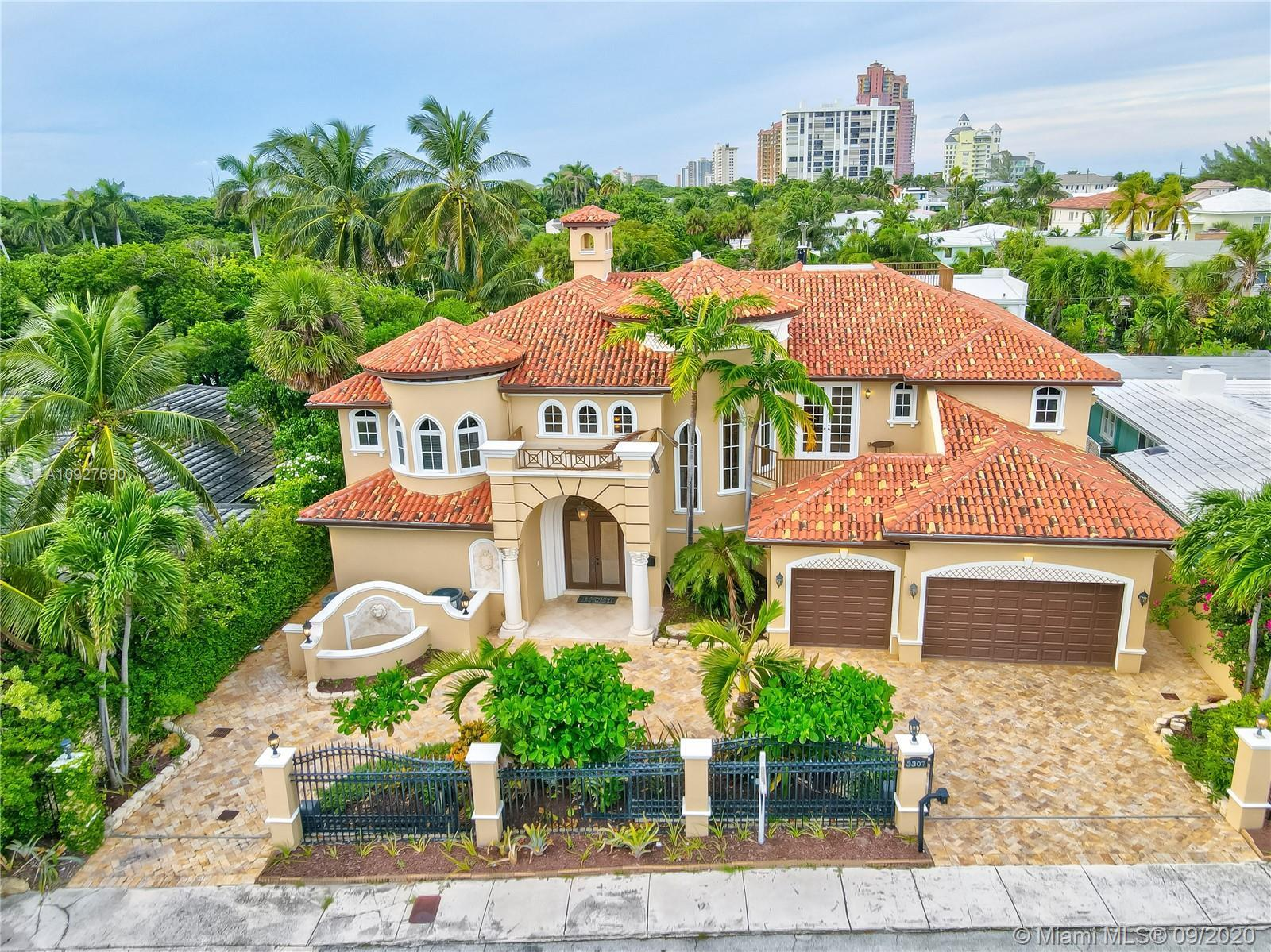 Just steps away from the beach, and completely secured. This one of a kind 6,500 sq ft Mediterranean