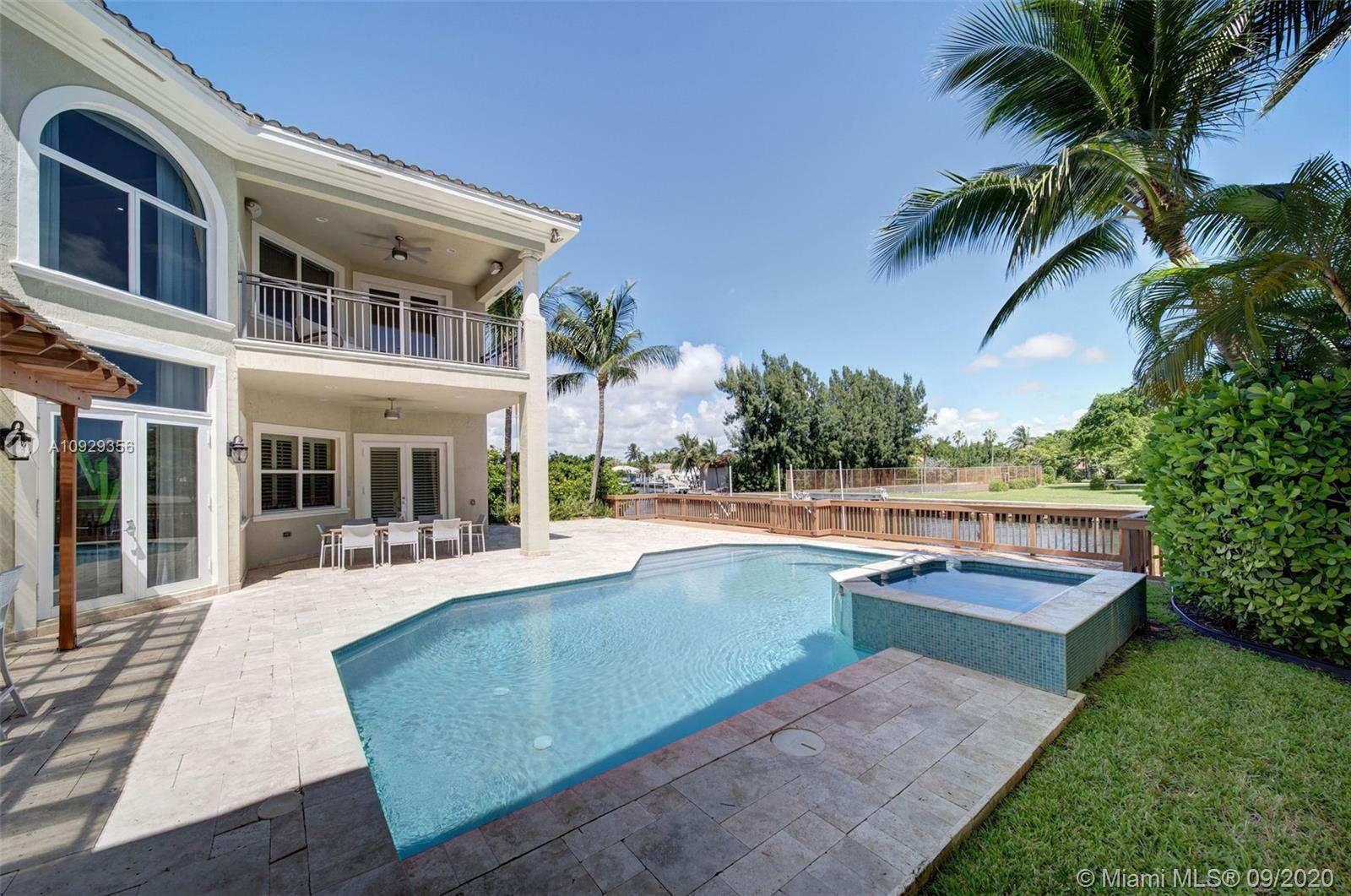 This luxury waterfront 2-story home is nestled on a quiet cul-de-sac in the prestigious guard/gated