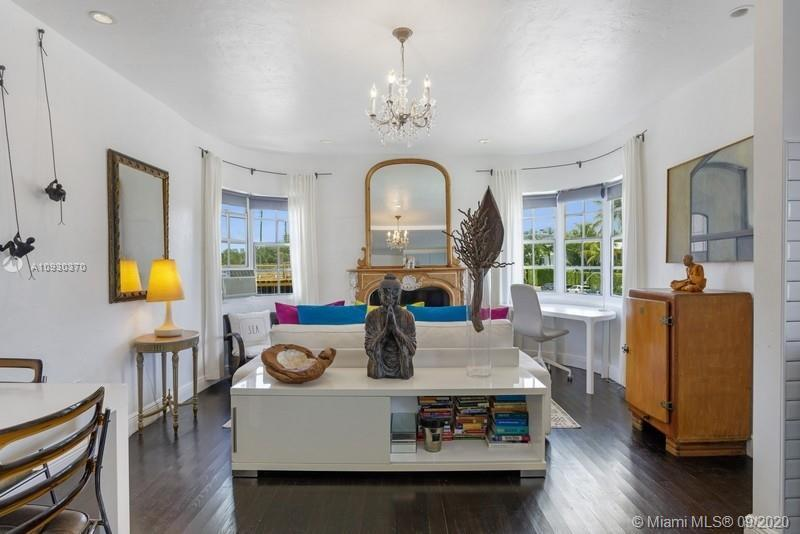 Top floor 1BR corner unit in classic Art Deco boutique-style building steps from Flamingo Park and a