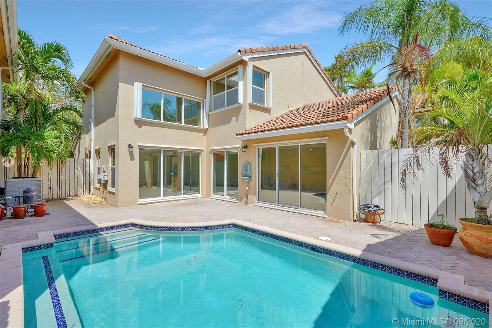 Fantastic, two story, 4/3 pool home with 1 bed/full bath downstairs in 24 hour guard gated community
