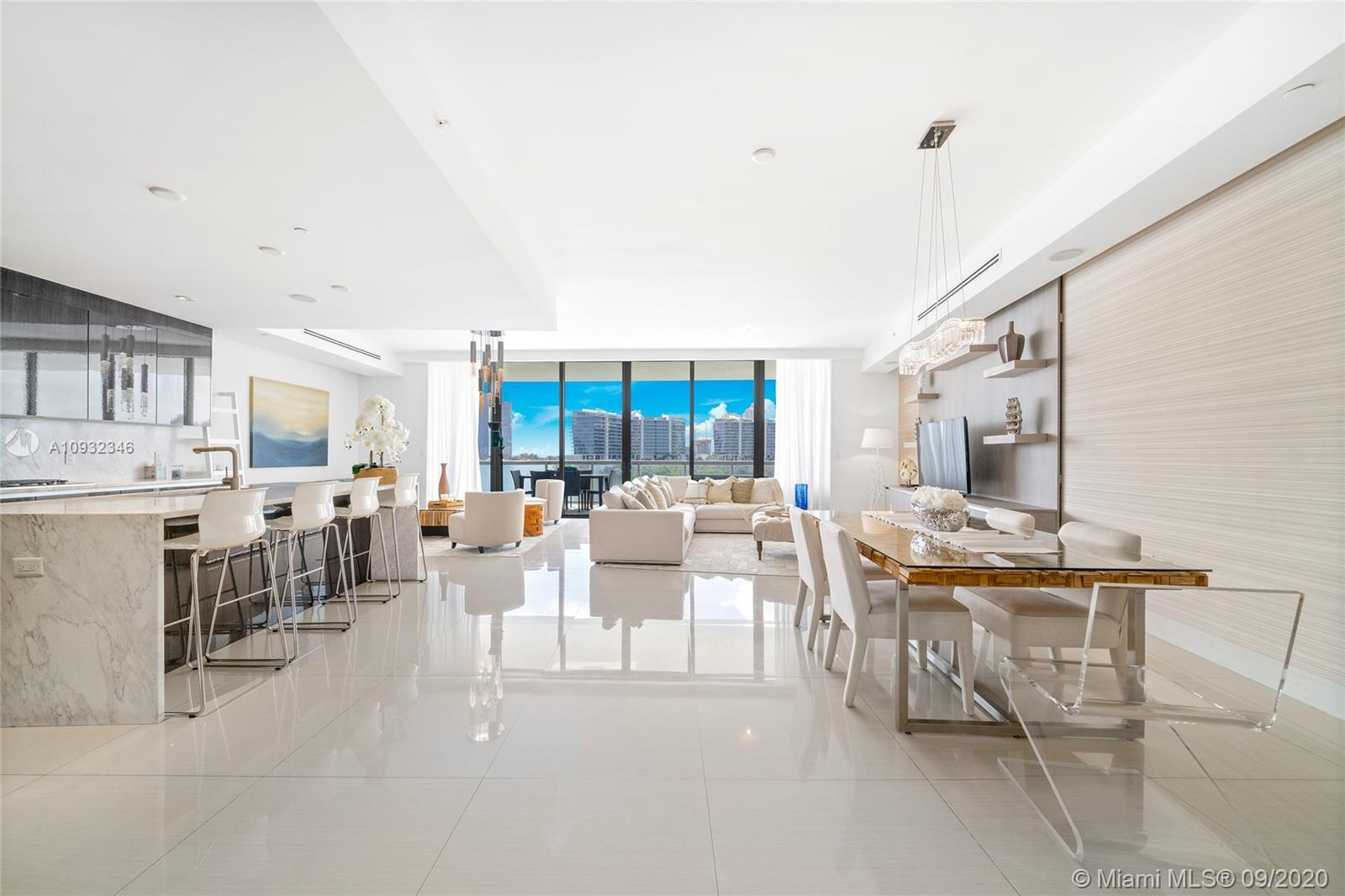 Live the good life from this gorgeous 3 bed 4.5 bath contemporary residence with intracoastal & city