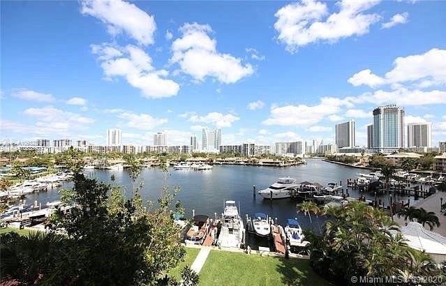 SPECTACULAR 2/2 CORNER WATERFRONT CONDO WITH UNPARALLELED VIEWS OF THE INTRACOASTAL & MARINA. OPEN C