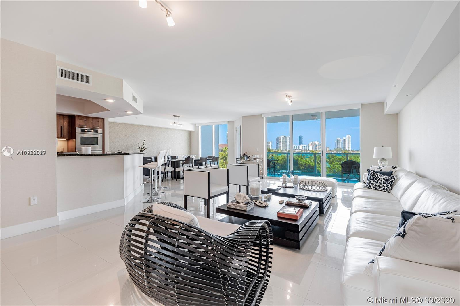 Spectacular view overlooking the Intracoastal, Sunny Isles, and pool. Bright 3 Bedrooms + Big Den an