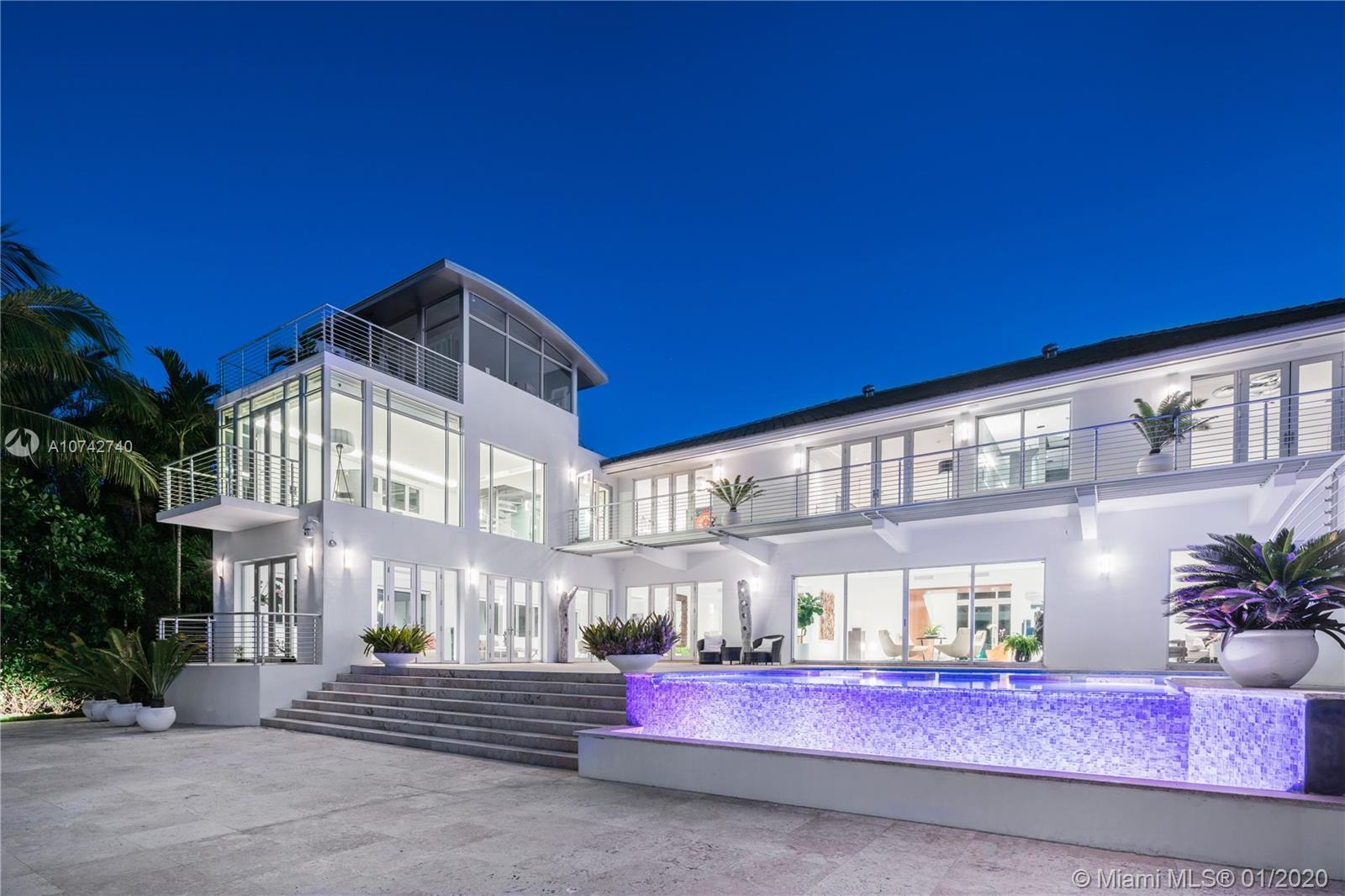 Entertain on a grand scale at this estate on Miami Beach's idyllic Sunset Island II. Your guests wil