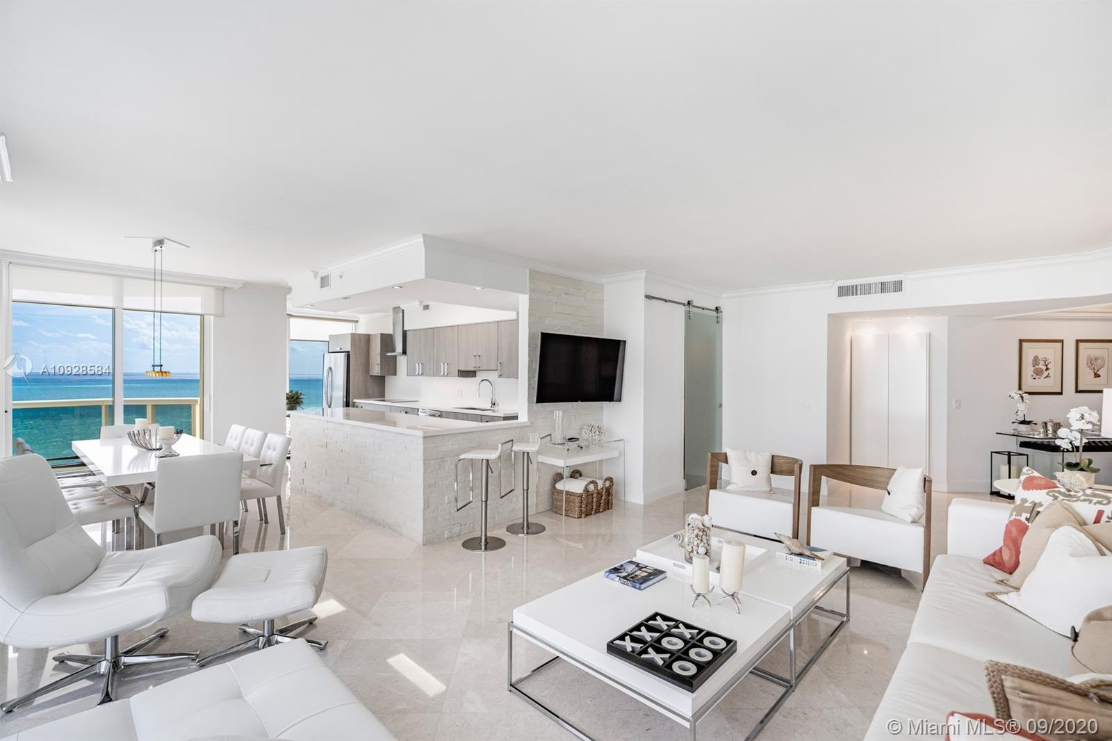 Spectacular is the only word that describes this substantially upgraded and impeccable oceanfront co