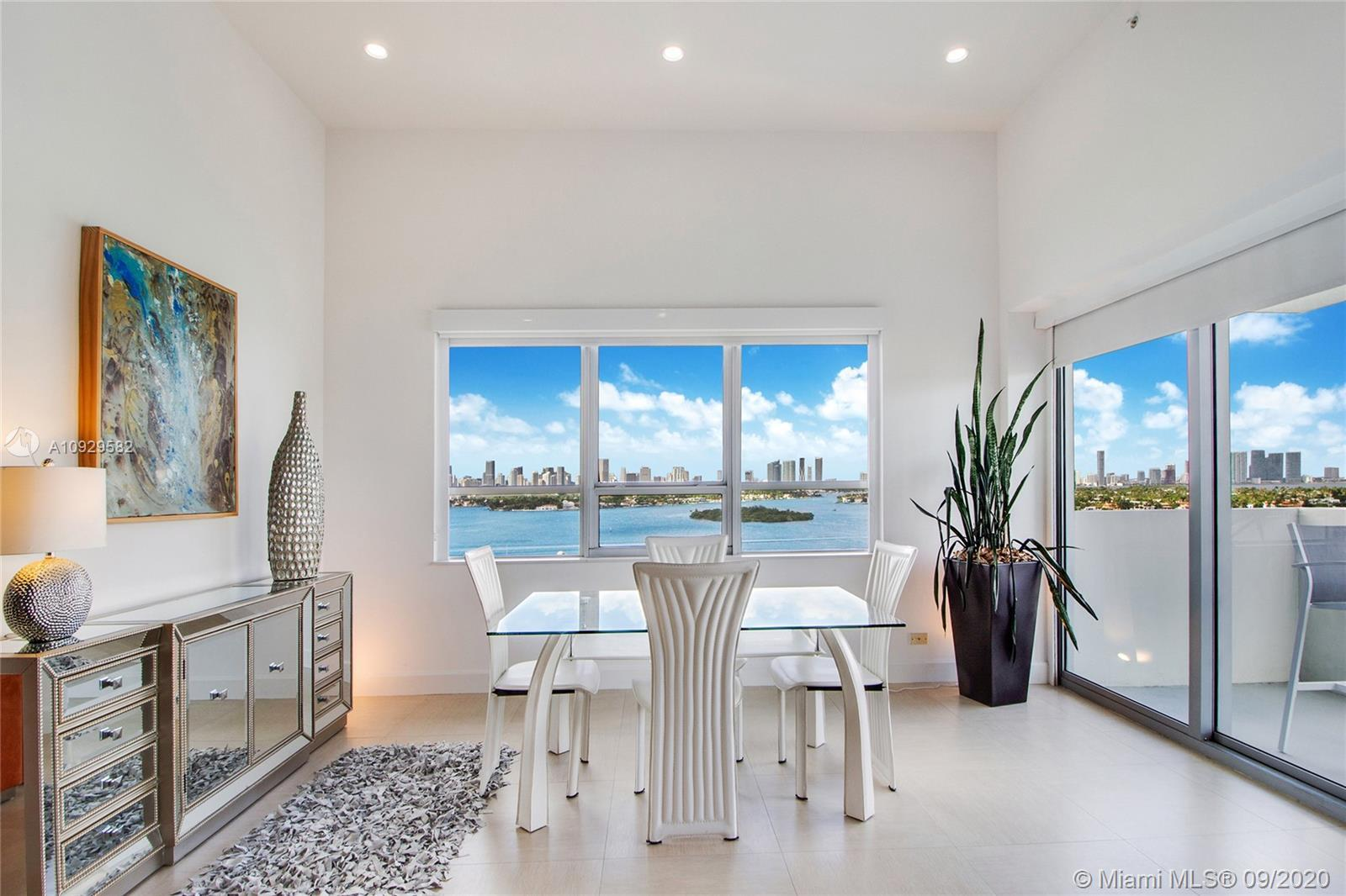 Spectacular Bay views from this completely and tastefully renovated PH 1 bedroom 1.5 bath with high