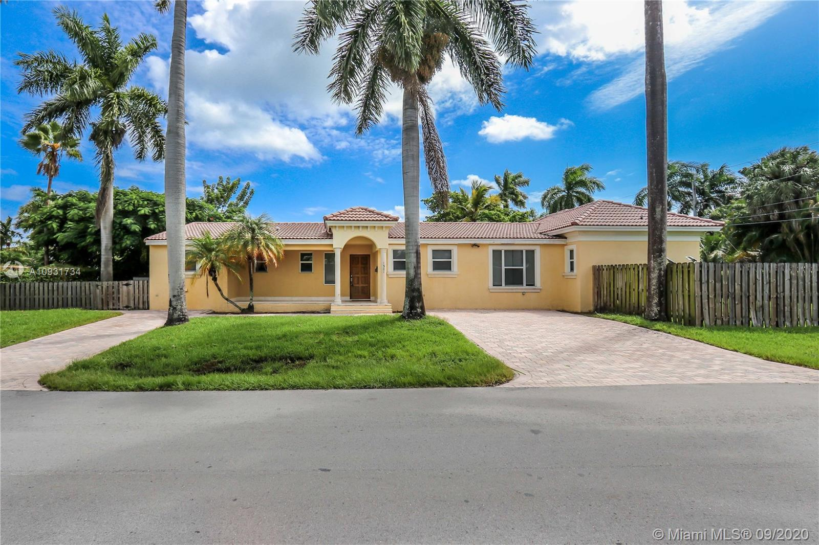 This bright corner home with great curb appeal has 4 bedrooms and 3 full bathrooms with elegant marb