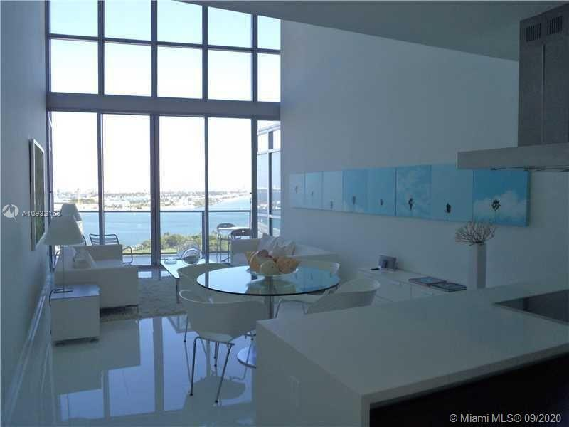 Fully upgraded gorgeous unit in the heart of Miami Downtown featuring 20' High Ceiling Loft style li