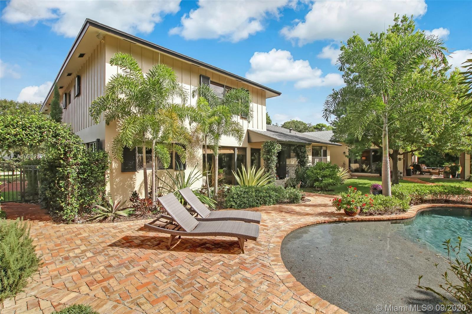 A remarkable blend of old Florida charm and modern convenience in this rare Jupiter home with water