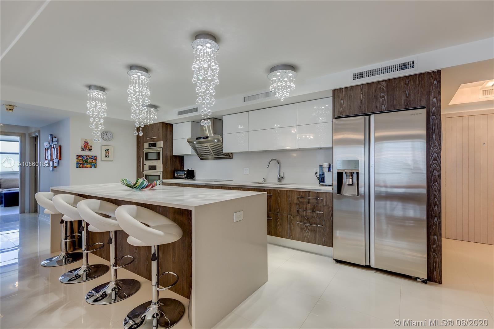 One of a kind, completely renovated, stunning three bedroom, three bath corner tower suite in exclus