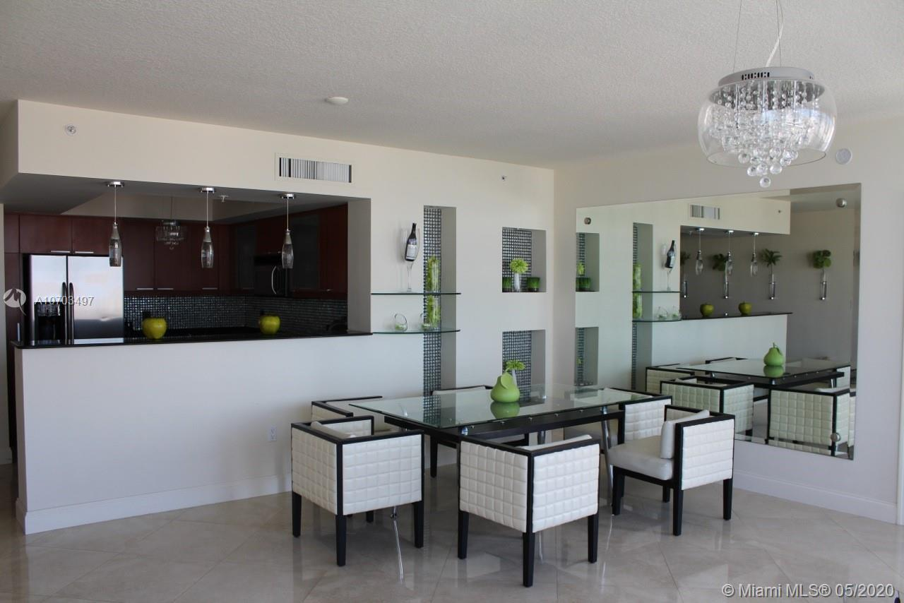 SPACIOUS CORNER 2/2 UNIT WITH SPECTACULAR OCEAN AND CITY VIEWS, DESIGNER DECORATED, OPEN KITCHEN WIT