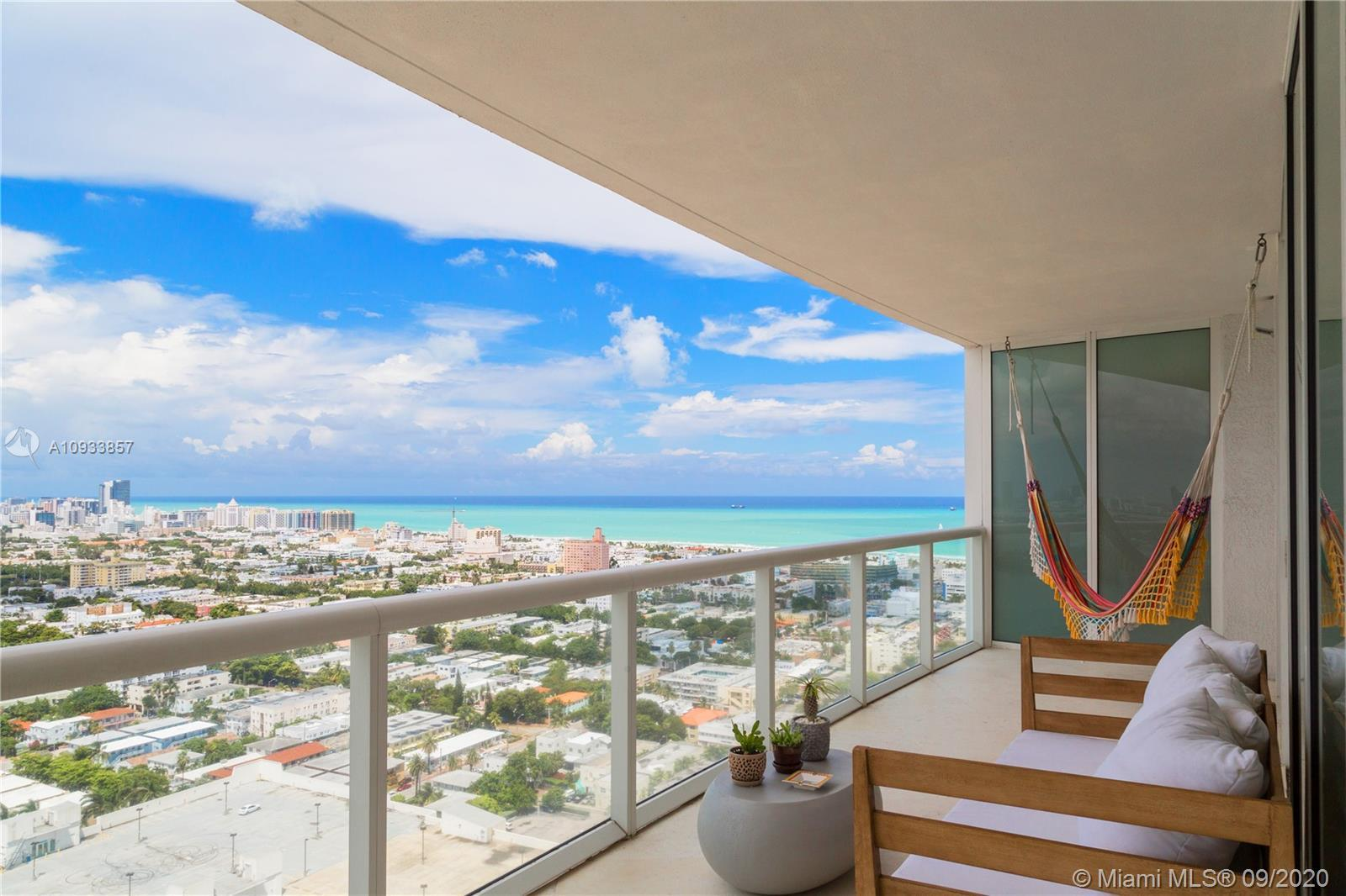 Spectacular wide ocean and city views from this stunning 2-bed/2-bath on the 31st floor at the ICON