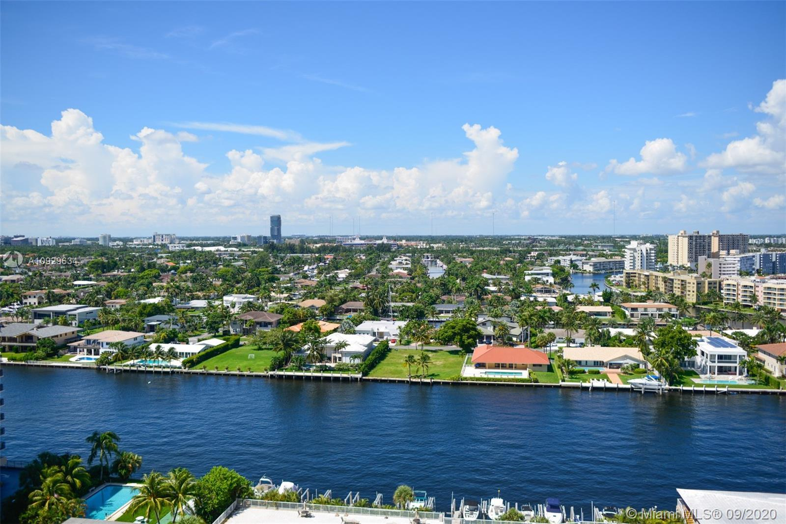 Location Location Location this 2/2 unit with direct inter-coastal views has porcelain floors, Light