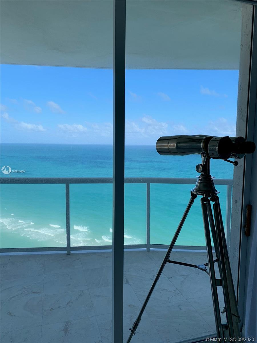 Lower Penthouse Unit. 3 Bedrooms plus Den and 3.5 Bath with 2,230 SQFT plus wrap-around balcony.  A