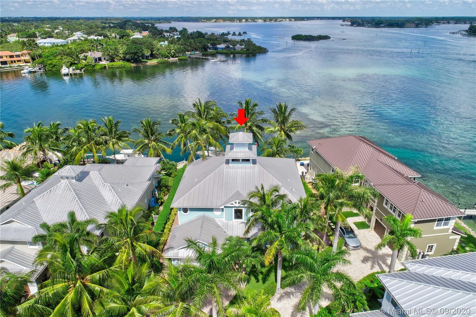 Stunning, wide blue water views from this Key West Riverfront home.  Nestled into this private gated