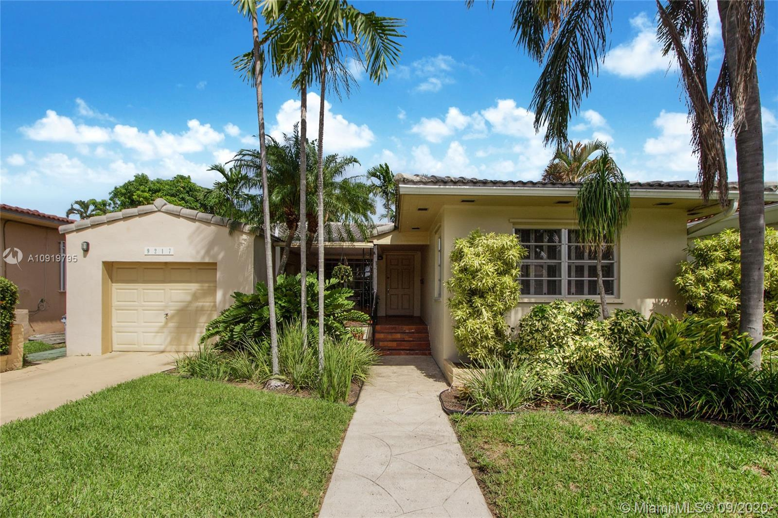 This charming Surfside home has 2 bedrooms, 2 bathrooms & a functional 1-car garage. An inviting cov