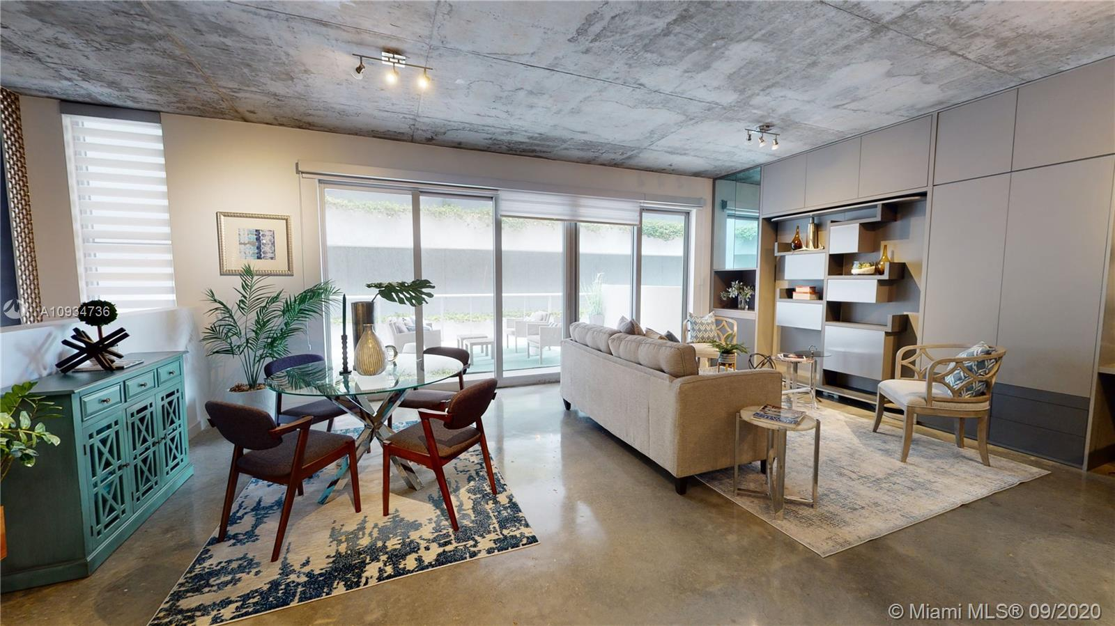 LIVE & WORK LOFT. MAGNIFICENT TRI LEVEL UNIT IN THE HEART OF MIDTOWN MIAMI. EXCELLENT OPPORTUNITY FO