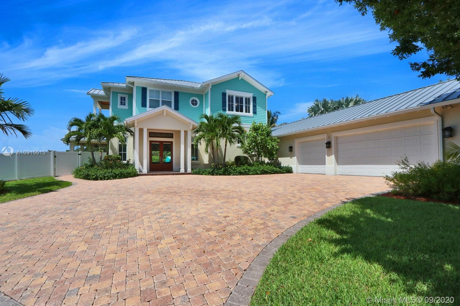 Just 5 minutes to the Jupiter Inlet!  This incredible New Riverfront Home is located on the Loxahatc