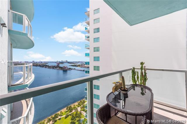 Located in front of Margaret Pace Park and with sweeping views of the bay, this high-floor 1BD/1BA i
