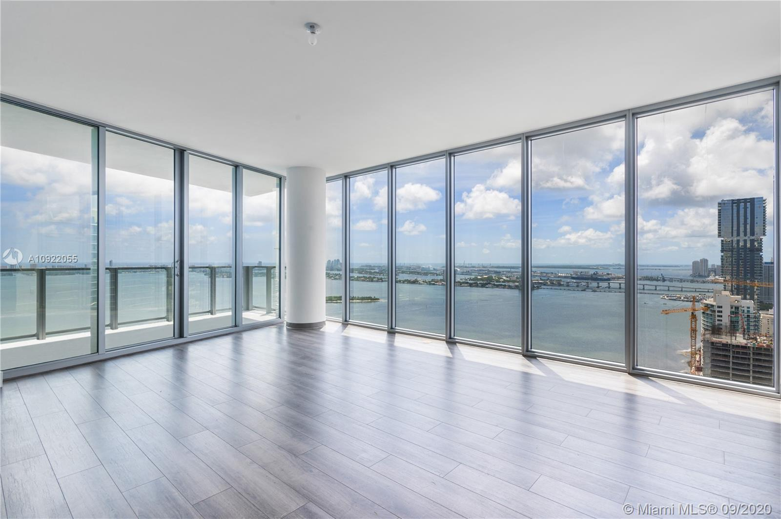 Imagine a life of exquisite taste in this beautifully never-lived corner residence at Biscayne Beach