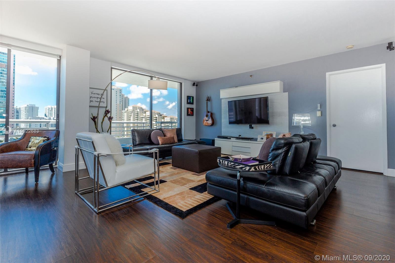 DON'T MISS OUT ON THIS OPPORTUNITY TO LIVE IN THE MUCH DESIRED AVENTURA. Breathtaking views of the I