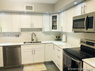 Amazing Beautifully Renovated 2/2.5  Apartment In Gated Grandview at Emerald Hills. Everything in th