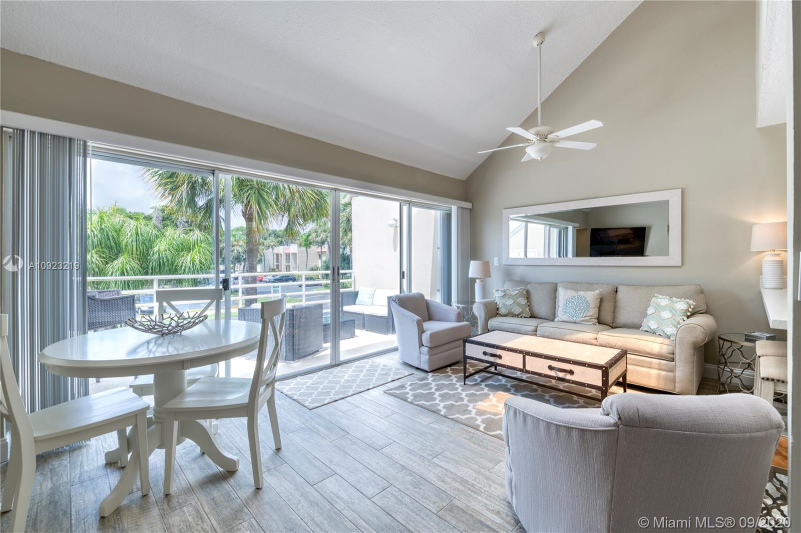 Walk to the gorgeous turquoise waters of Jupiter Beach from this beautifully renovated 2 bed, 2 bath