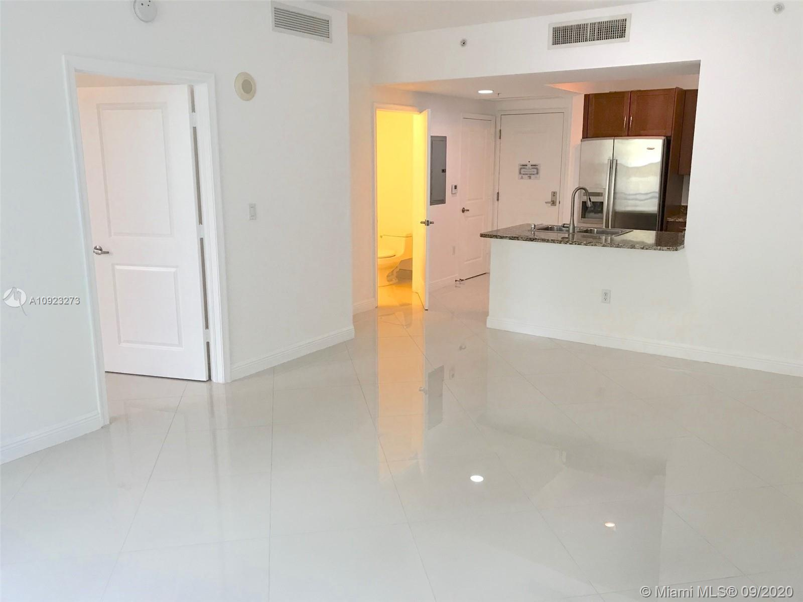 Beautiful and bright 835sf 1bed/1.5bath . . . Brand new shining porcelain flooring throughout! Move-