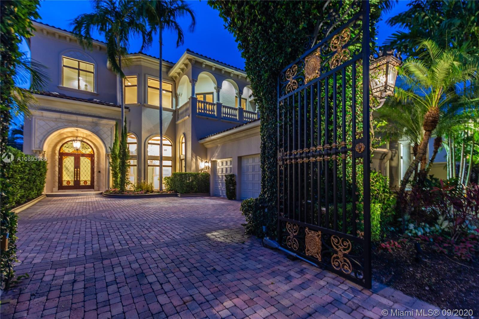 Rare opportunity to own a home in the ultra-exclusive ''Mizner Lake Estates'' community. Located on